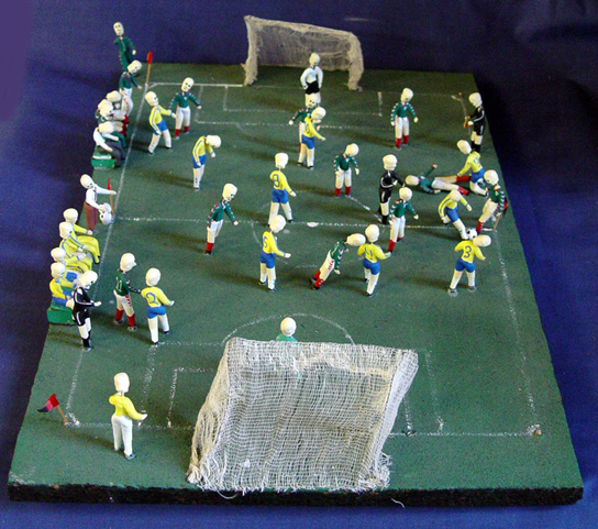 Model group in the form of a skeleton football match (Mexico v Brazil). Inspired by Day of the Dead Festival. Mexico, 1980s. (Am1986,06.271)