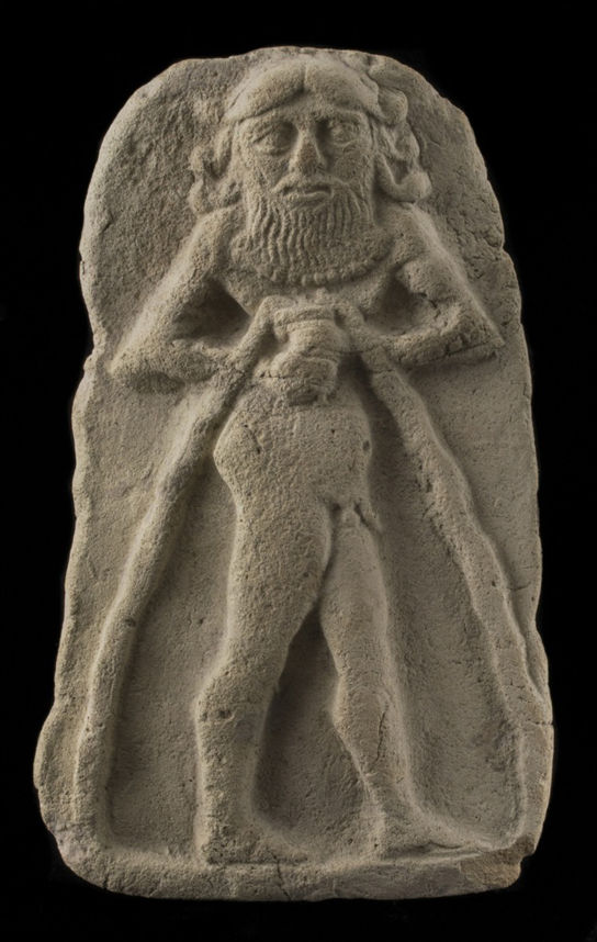 An almost 4,000-year-old fired clay relief depicting a nude hero. One of a pair of reliefs made from the same mould (British Museum 1924.0920,74)