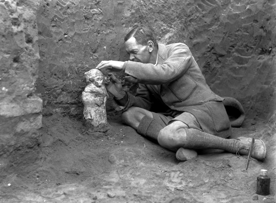 Leonard Woolley excavating an almost 4,000-year-old votive figurine in the shrine of Hendursag (1930–­31)