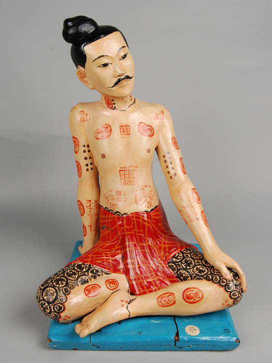Figure of a Shan tattooed man of strength. Mong Nai, Shan State, Burma/Myanmar, Late 1800s to early 1900s. Stucco (As1930,1018.1)