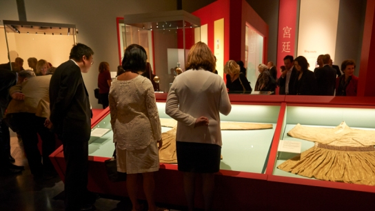 Visitors looking at some of the exquisite textiles on show in the exhibition