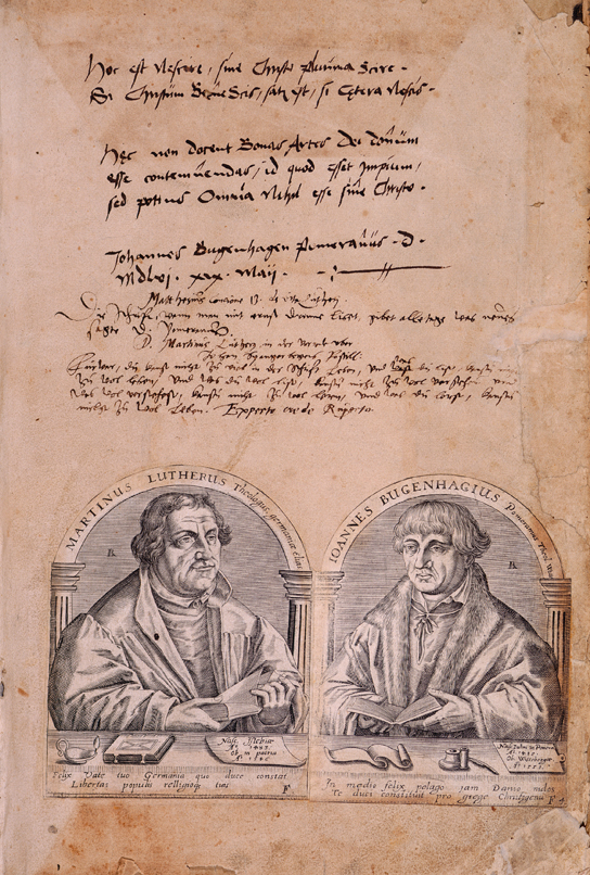 The front end paper of Luther's 1541 Bible with portraits of Luther and Johannes Bugenhagen and Luther's transcription from the 21st psalm and signature. Biblia, das ist, die gantze Heilige Schrift: Deudsch auffs new zugericht. D. Mart. Luth., etc. (Wittemberg, 1541). © British Library 679.i.15.