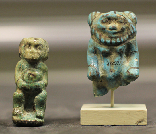 Two faience figurines from Petrie's tomb G62 at Abydos: a female dwarf and the god Aha. (EA 37298 and EA 37297)