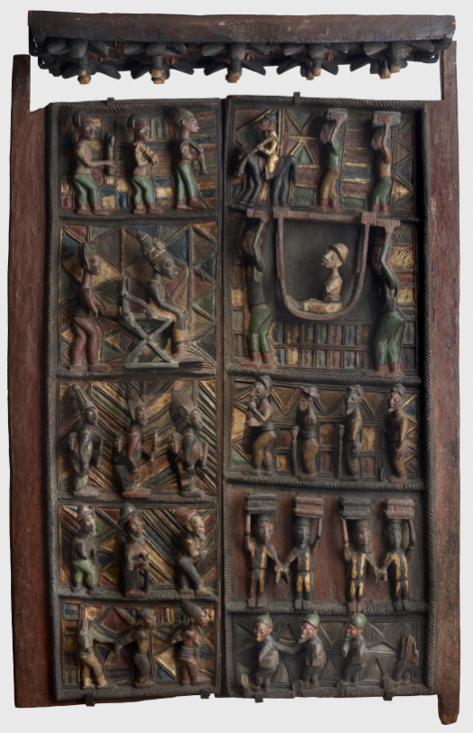 Door panels and lintel  from the palace of the Ogoga (king) of Ikere in Nigeria. They depict the arrival of a British administrator in the Ogoga's palace around 1899-1901. Af1924,-.135.a-b