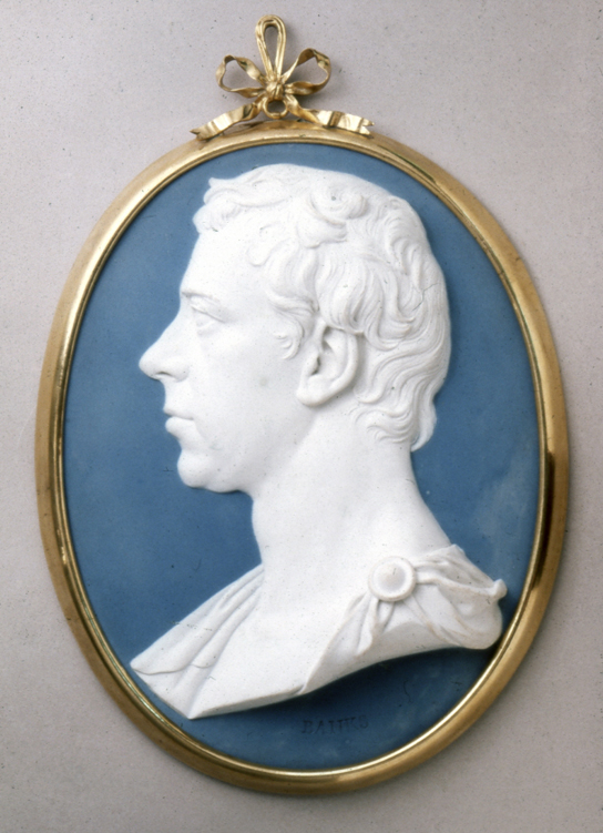 Portrait medallion of Sir Joseph Banks, English naturalist. Jasper ware (stoneware) dipped blue. Modelled by John Flaxman (fl.1754-1826) , made in the factory of Wedgwood & Bentley (1887,0307,I.60)