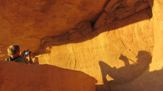 David Coulson (Trust for African Rock Art) photographing rock art in Chad