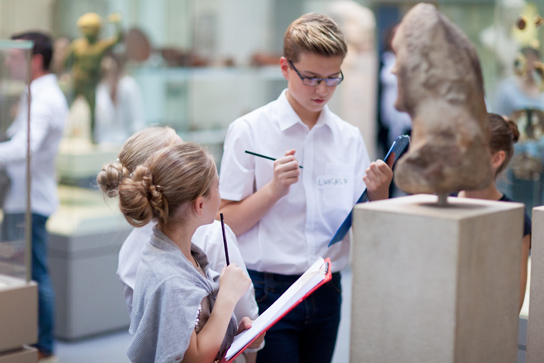 Students from EC Lighthouse researching the objects in the Roman Empire gallery. Photo © Benedict Johnson