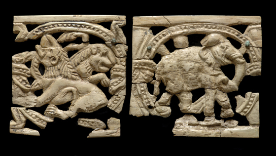 Lions and elephant carved in openwork