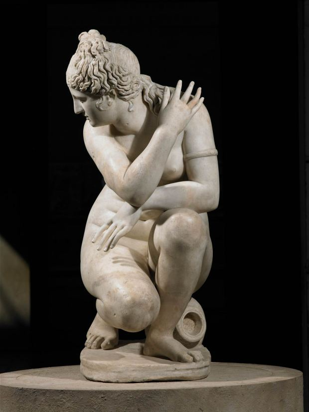 Marble statue of a naked Aphrodite crouching at her bath