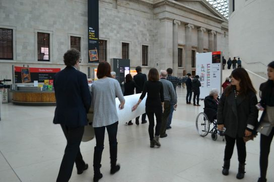 The print being taken through the Great Court to the World Conservation and Exhibitions Centre.