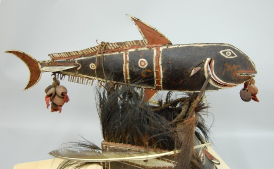 Detail of a mask in the form of a human face and a bonito fish Attributed to Kuduma, Muralag, Torres Strait, Queensland. Turtle shell, goa nut, cassowary feather, shell, paint. H 310 mm. British Museum, London Oc,89+.74