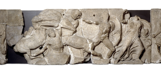 Section of frieze from the temple of Apollo Epikourios at Bassai, 420–400 BC. As Kaineus is hammered into the ground, his muscular, twisting torso aligns him with the heroic Lapith warrior who comes to his aid, and contrasts with the swirling drapery of the female escaping to the side. British Museum, London 1815,1020.4