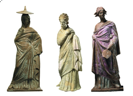 Terracotta figures of a woman. Greek, about 300–200 BC or later. Said to be from Tanagra, Boeotia. British Museum, London 1875,1012.9; 1875,1012.12a; 1874,0305.65