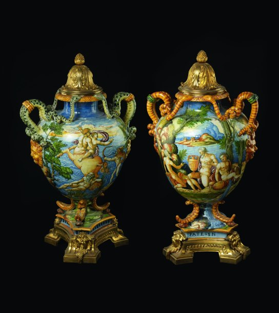 Pair of maiolica vases illustrating the story of Hercules and his wife Deianira (left) and river gods among a lush landscape (right). Made in Urbino, Italy, 1561–1571. The brass-gilt mounts were added later, in Paris before 1765. H. 56 cm. British Museum WB.61a and 61b