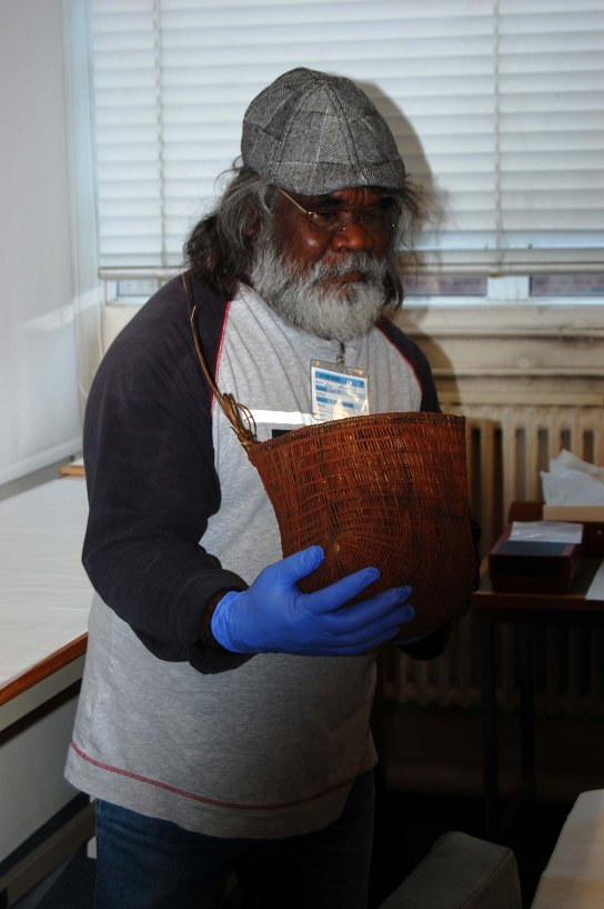 Abe Muriata studying bicornual baskets in the British Museum store, 2015.