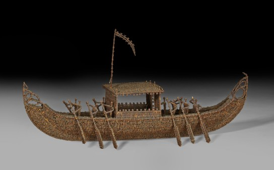 Model boat made from threaded cloves before conservation, AD 1700s–1900s, probably from Indonesia, L 58 cm, H 30 cm, D 23 cm. British Museum As1972,Q.1944