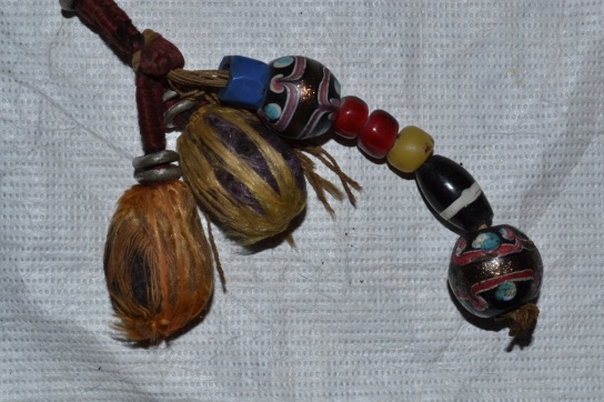 Two millefiori beads attached to the lyre.