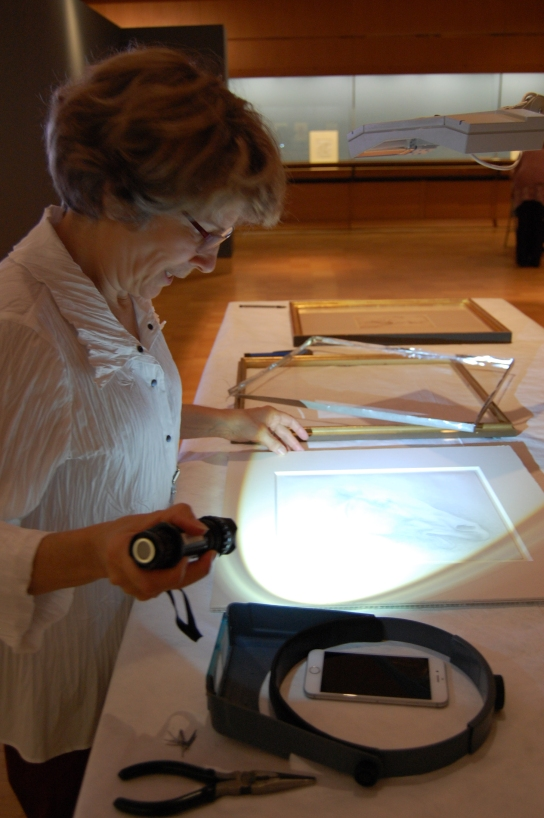 In this picture you can see the conservator Kim Schenck condition checking some of the drawings from the National Gallery of Art.[HYPERLINK TO NGA Exhibition Webpage].